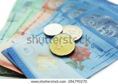 Money banknotes and coins, closeup - stock photo
