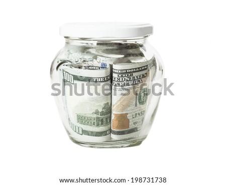 Money banknotes jar full of savings isolated on white background - stock photo