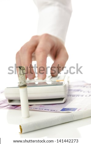 Money being burned away by smoking. Concept of unreasonable  money spending for harmful cigarette addiction.