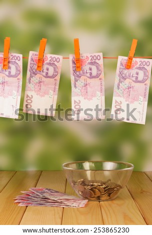 Money bills on the outdoor table - stock photo