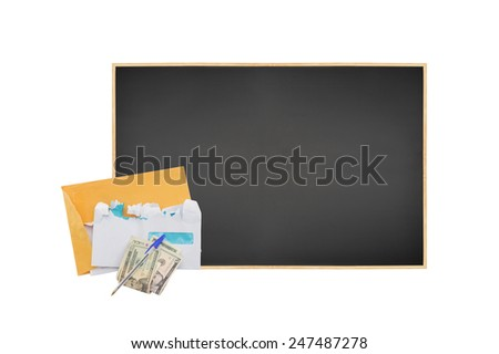 Money Bills Pen on table leaning on blank blackboard isolated on white background - stock photo