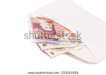 Money British pounds sterling gbp in envelope isolated on white - stock photo