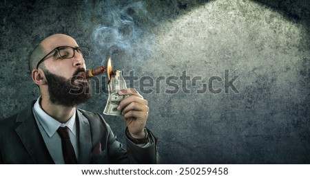 money burning - businessman arrogant  - stock photo