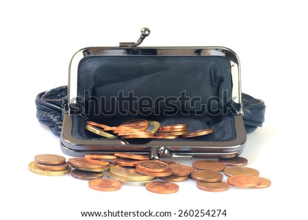 Money coins inside black leather purse, white background. - stock photo