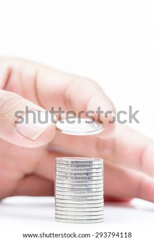 Money coins pile isolate on white background,hand putting on money coin saving and business growth concept,focus at coin pile - stock photo