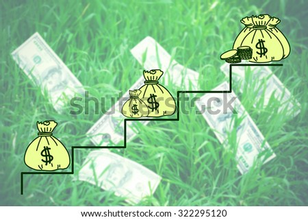 Money concept. Banknotes money over green grass background - stock photo