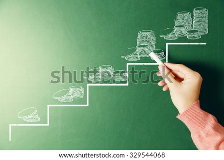 Money concept.Female hand drawing on blackboard. - stock photo