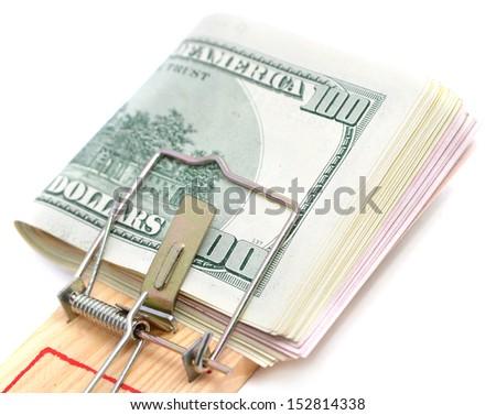 Money concept, money on mousetrap closeup - stock photo