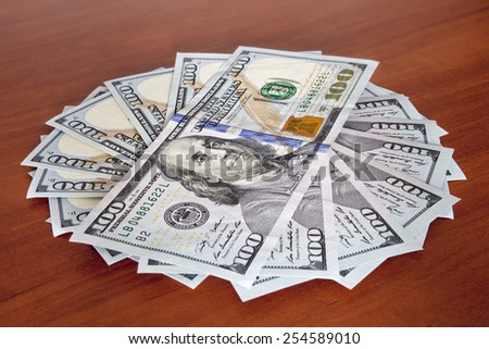 money concept - several dollars banknotes on the table - stock photo