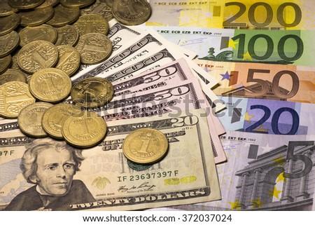 Money dollar euro hryvnia - stock photo