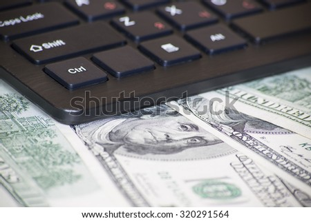 Money, dollar,  internet, keyboard, income, job, internet, computer - stock photo
