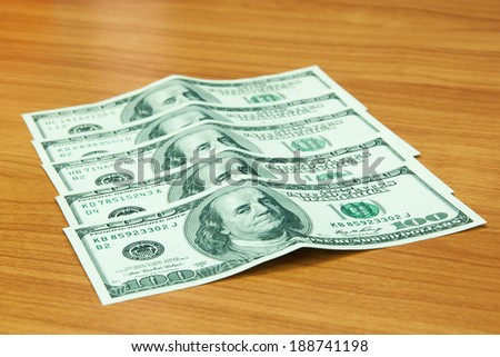 Money Dollars on the wood table - stock photo