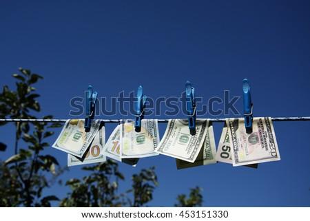 Money dollars rope - stock photo