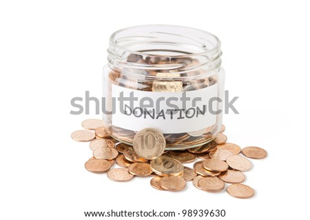 Money donation in a glass jar isolated on white - stock photo