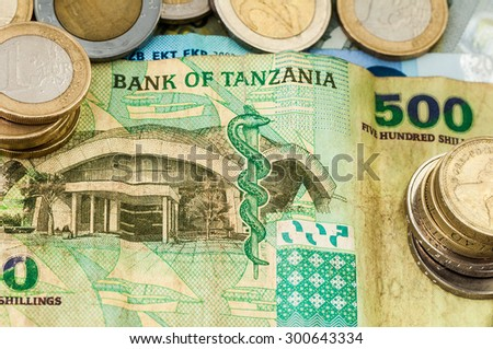 Money Euro Bank of Tanzania Bill one and two Euro Coins - stock photo