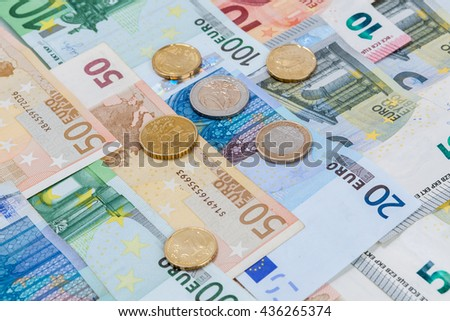 Money euro coins and banknotes in studio on white background. - stock photo