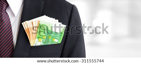 Money, Euro currency (EUR) banknotes, in businessman suit pocket - business and financial panoramic (header) background concept - stock photo