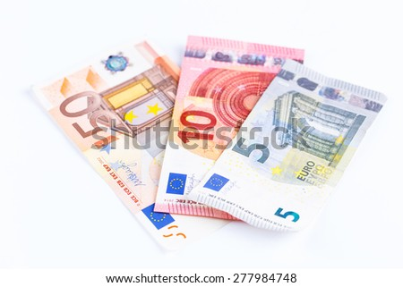Money, Euro currency (EUR) bills on a white background.