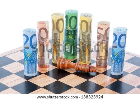 Money euro on chess board and Defeated figure of the king. - stock photo