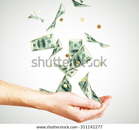 Money falling into the hands concept