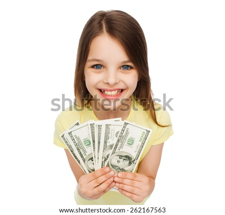 money, finances and people concept - smiling little girl with dollar cash money