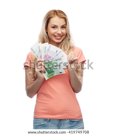 money, finances, investment, saving and people concept - happy young woman with euro cash money - stock photo