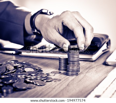 Money, Financial, Business Growth concept, Close-up Of Businessman Hand Count and Put Money Coins To Stack Of Coins - stock photo