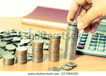 Money, Financial, Business Growth concept, Close up Of Businessman Hand Count and Put Money Coins To Stack Of Coins - stock photo
