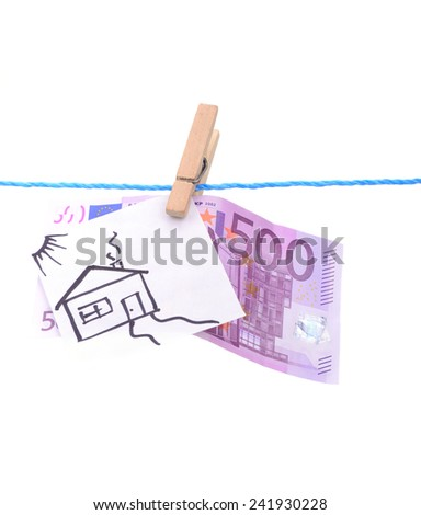 money five hundred euros and drawing at home hanging on a blue twine attached wooden pin isolated on white background - stock photo