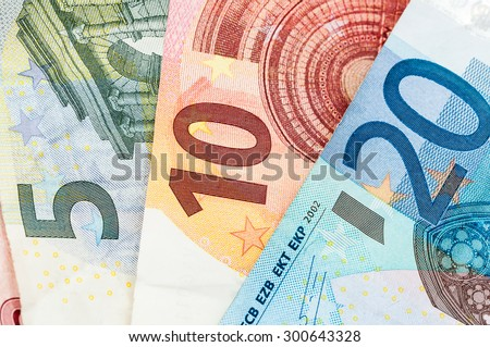 Money five, ten and twenty Euro Bills in a row - stock photo