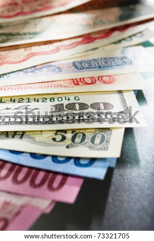 Money from different countries, arranged overlap of each other - stock photo