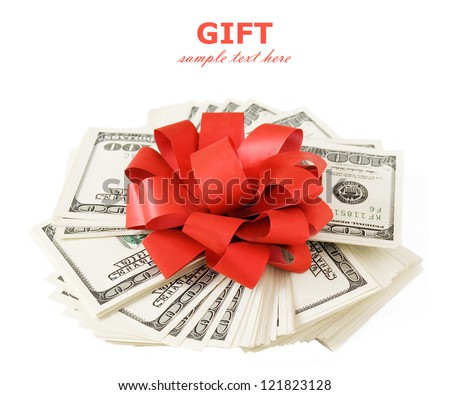 Money gift (big stack of dollars with red bow isolated on white background)
