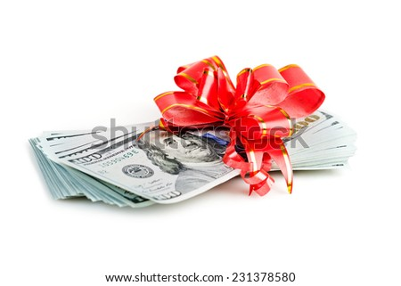 Money gift, big stack of dollars with red bow isolated on white background
