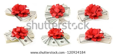 Money gift set with red bow isolated on white background - stock photo