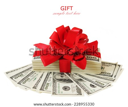 Money gift. Stack of money with red bow isolated on white background - stock photo