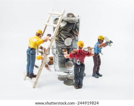 Money grab and human greed concept as young employees scramble up to success and a lot of money. - stock photo