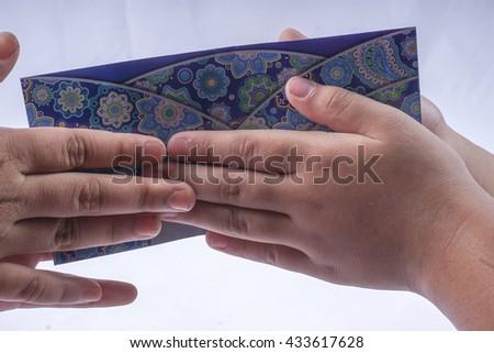 Money Green Packet for Ramadan and Ramadan and Eid ul Fitr Celebration - stock photo