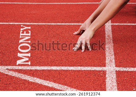 money - hands on starting line - stock photo