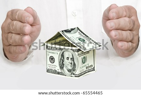 Money house and hands