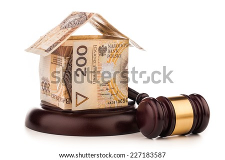 money house  and judge gavel isolated on white