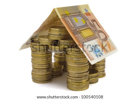 money house with coin isolated over white background - stock photo