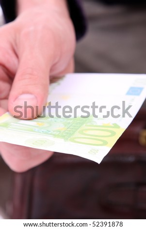 money in a businessman hands over white background