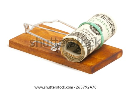 Money in a mousetrap isolated on a white background