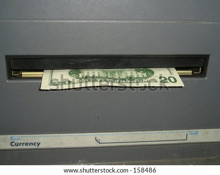 Money in an ATM - stock photo