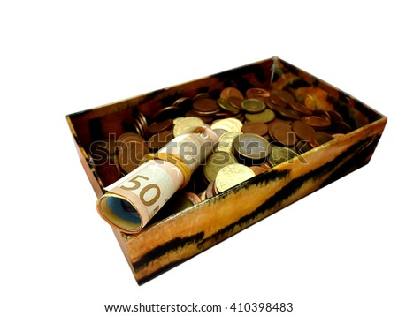 Money in an old box, banknotes and coins, isolated on white