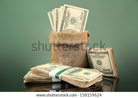 Money in  bag  on dark color  background - stock photo
