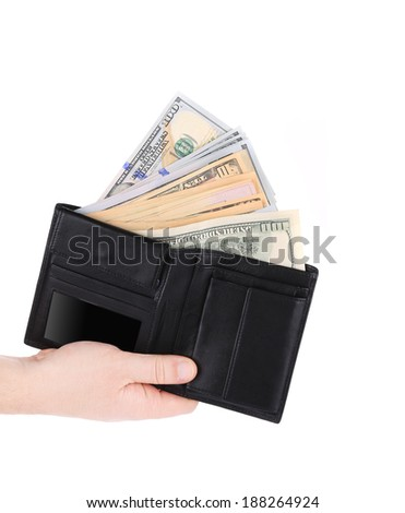 Money in black leather wallet on hand. Isolated on a white background.