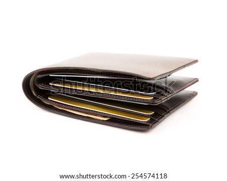 Money in brown leather wallet full of cards on white background - stock photo