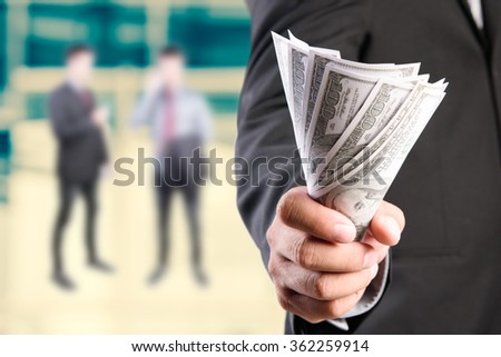 Money in Businessman hand , US dollar,investment, success and profitable business concepts - stock photo