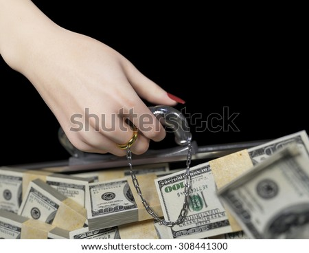 money in case and woman hand with wedding ring marriage of convenience concept  - stock photo
